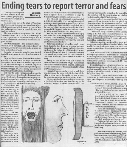 photograph of a page in a newspaper with an illustration of two women