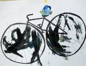 breast print turned into a fish riding a bicycle