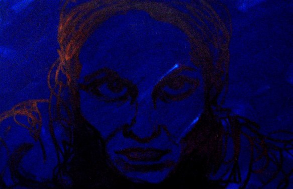 self-portrait of the artist in blue and black tints; close-up of face