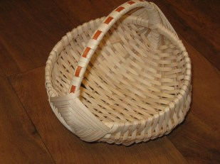 cane egg basket with wrapped handle