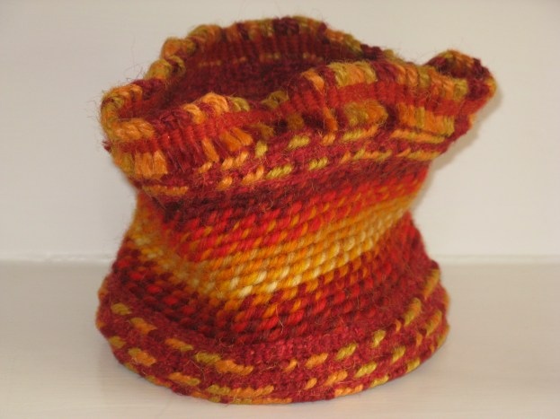 twined basket, jute and wood