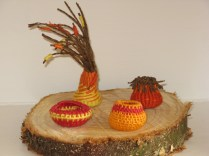 twined and coiled miniature baskets
