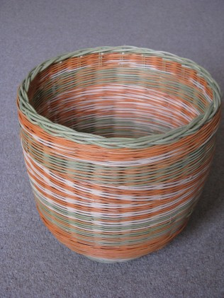 Dyed and natural cane basket