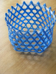 hexagonal weave basket; plastic strapping tape