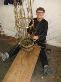 Sally Roach making round willow basket