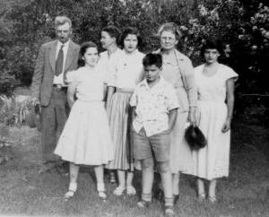 Moore Family At the Parker Reunion Aug 1951: J.R., Sally, Ola, Helen, Arthur, Grandmother Tennie Parker, Jane – [My father had just been released from the veterans hospital after a six-week stay following his first massive heart attack. – note Mama's concern]