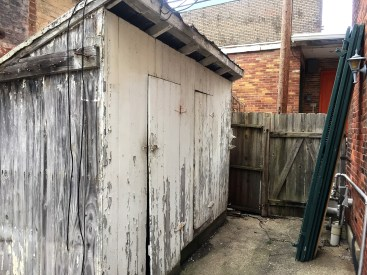 Former outhouse (two holes!), now a storage shed