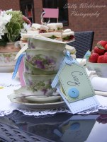 Vintage tea cup stack with handmade name labels wiTh buttons and ribbon