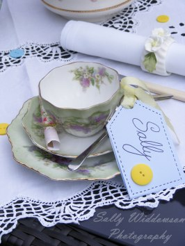 Vintage tea set place setting for hen do with teacup, saucer, side plate, spoon and handmade name label with ribbon and button