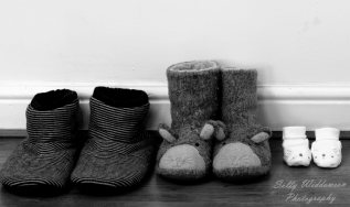 Mum dad and baby slippers in a row black and white