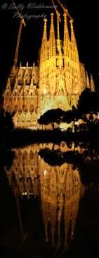 Basilica de la Sagrada Familia Barcelona Spain Nativity Facade reflected in ornamental pond