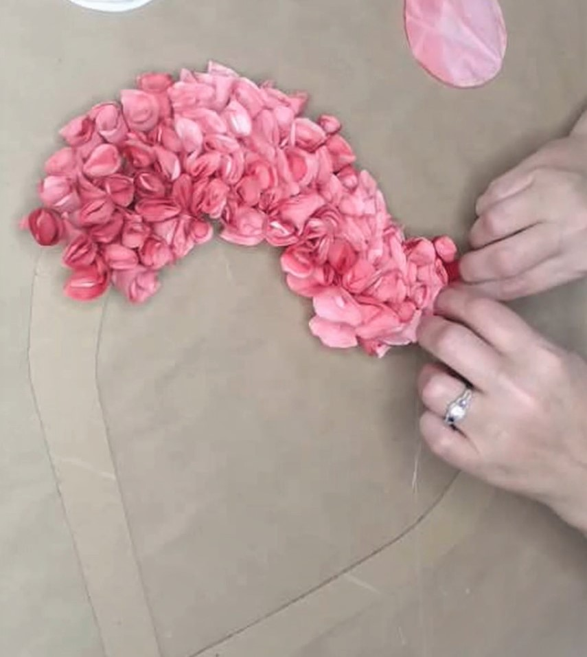 Adding coffee filter style cupcake liner flowers to Heart Wreath