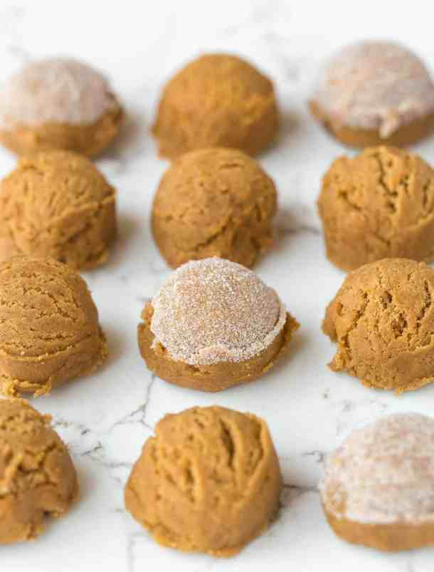 Small balls of gingersnap cookie dough dipped in granulated sugar.