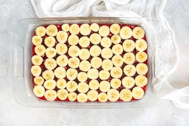 Pomegranate Jell-O topped with sliced bananas.