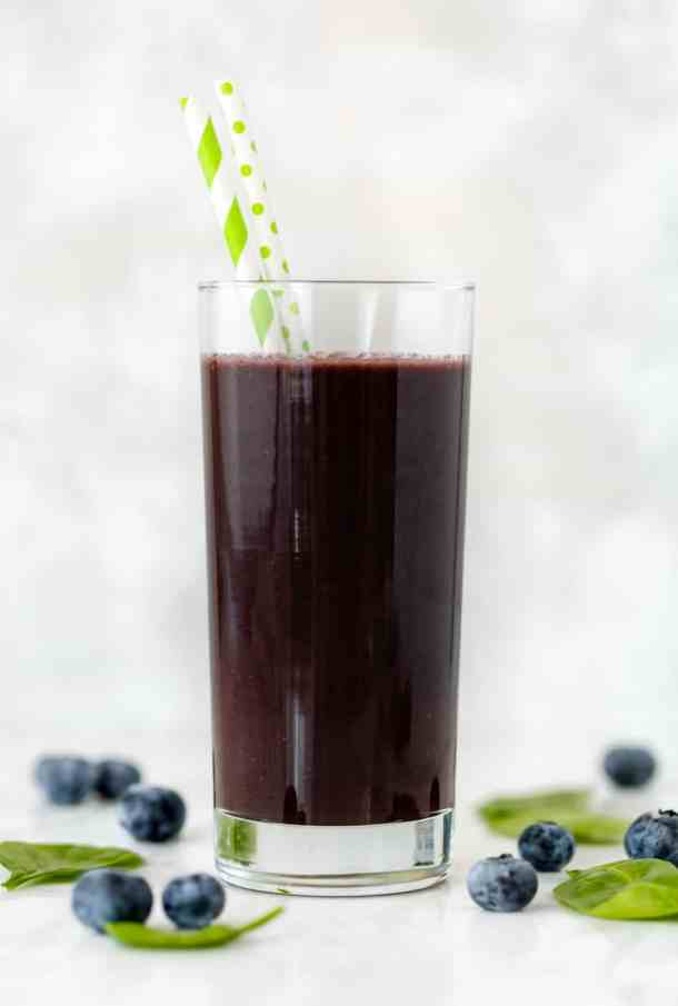 A healthy açaí smoothie containing blueberries, spinach, carrots, and chia seeds.