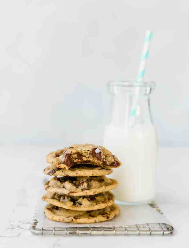 Chocolate chip cookies sprinkled with sea salt and a glass of milk.