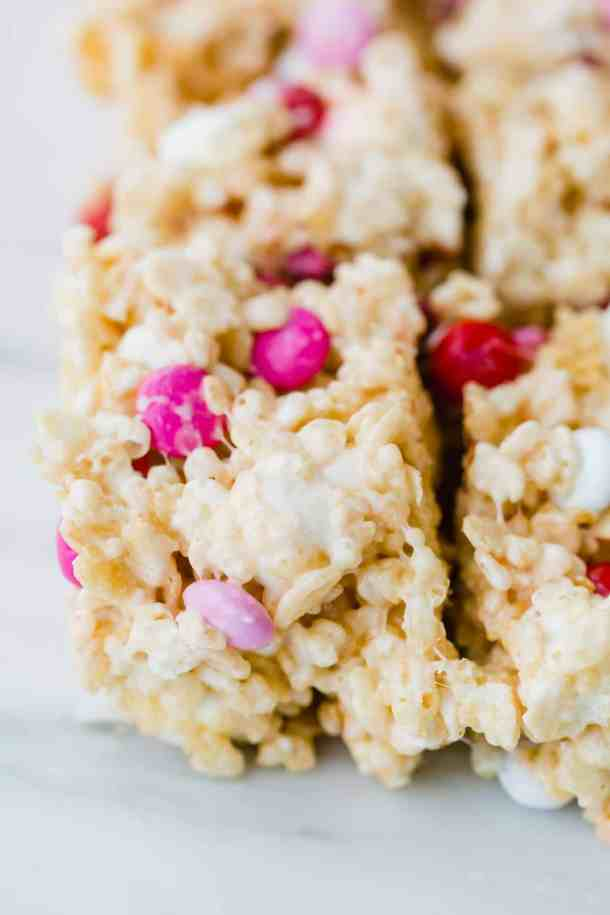Rice Krispy treat with pink, red, and white M&M's.