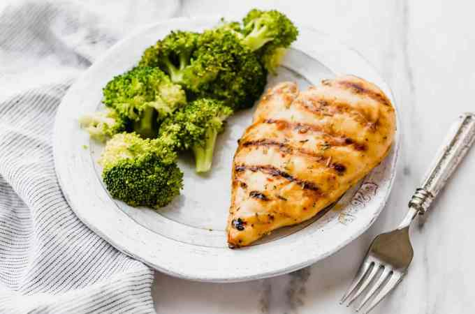 Delicious Italian Marinated Grilled Chicken with a side of broccoli.