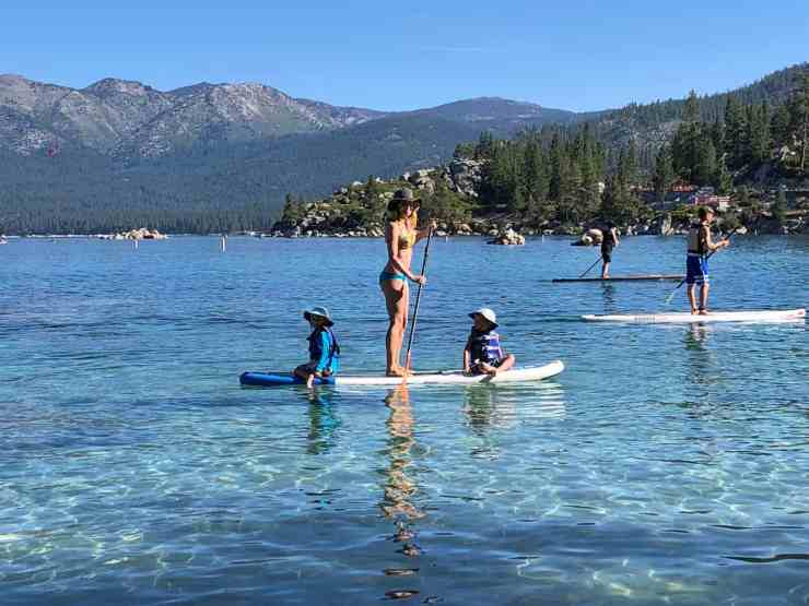 mom paddling in lake tahoe with kids on a SUP
