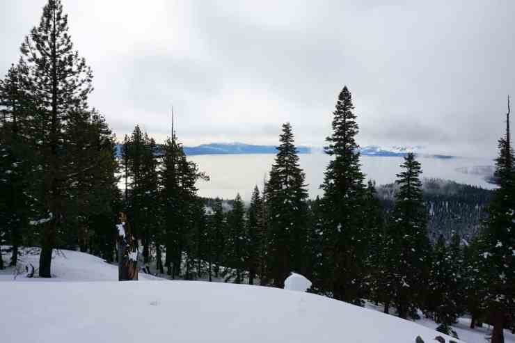 View of lake tahoe on a cloudy day from up on a viewpoint. One of my favorite things to do in Lake Tahoe during the winter is snowshoe up to this viewpoint.