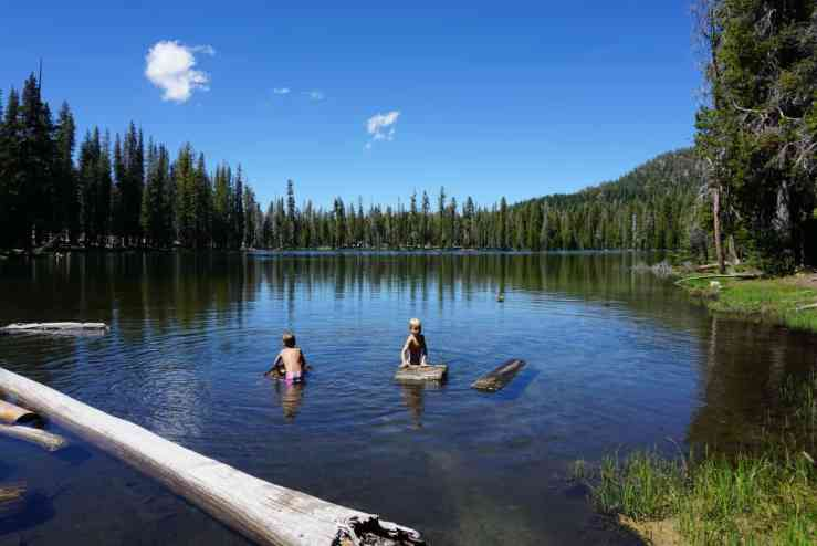 Two little boy splaying in Summit Lake in Lassen National Park.