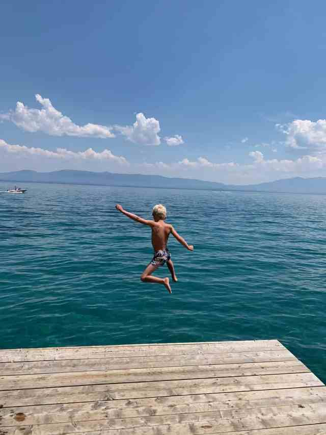 jumping off a dock at sugar pine state park in lake tahoe
