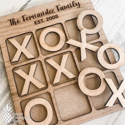 Personalized tic tac toe board with X and O pieces