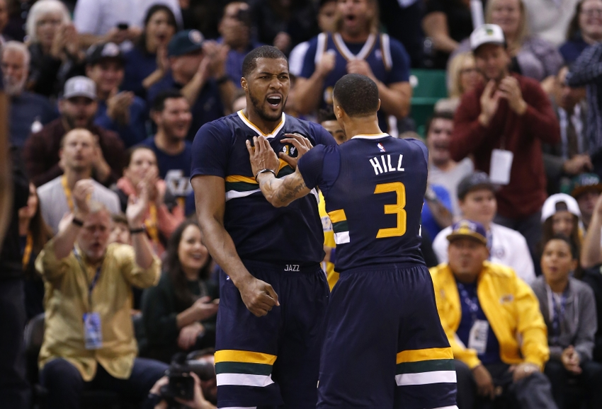 Oct 28, 2016; Salt Lake City, UT, USA; Utah Jazz forward Derrick Favors (15) is congratulated by guard George Hill (3) after a basket and a foul in the second quarter against the Los Angeles Lakers at Vivint Smart Home Arena. Mandatory Credit: Jeff Swinger-USA TODAY Sports