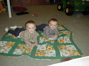 Will_and_joe_on_debs_quilt