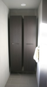New storage cabinets were installed where the old shower was
