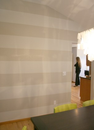 Pale horizontal stripes to add some subtle visual interest to the large dining room wall