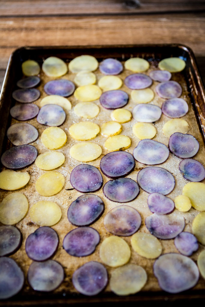 Potato slices arranged in a single layer, ready for baking.