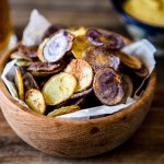 Crispy oven-baked potato chips – healthier than fried potato chips and just as delicious.