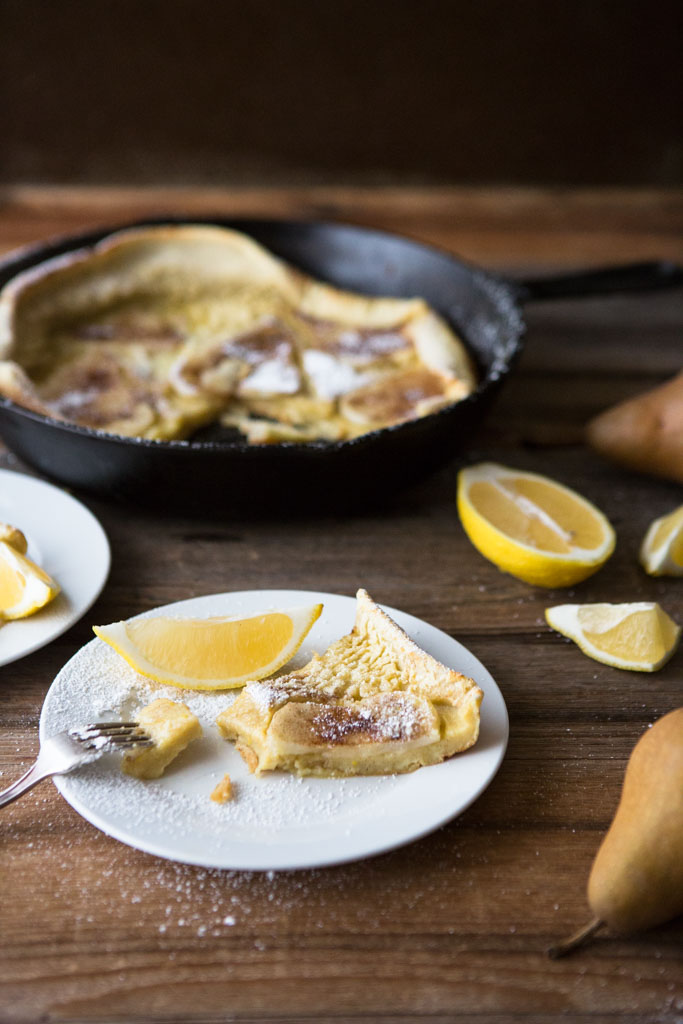 Serve the Dutch Baby with Spiced Pears with slices of lemon and a sprinkling of powdered sugar.