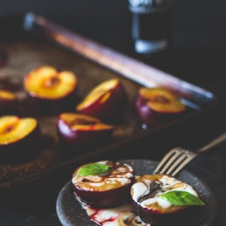 Plums are quickly roasted and caramelized with olive oil and brown sugar, then topped with yogurt or ice cream and balsamic.