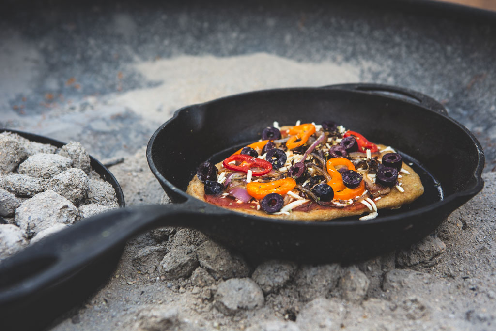 Campfire pizza made with prepared dough makes a quick, delicious dinner that's a crowd pleaser.