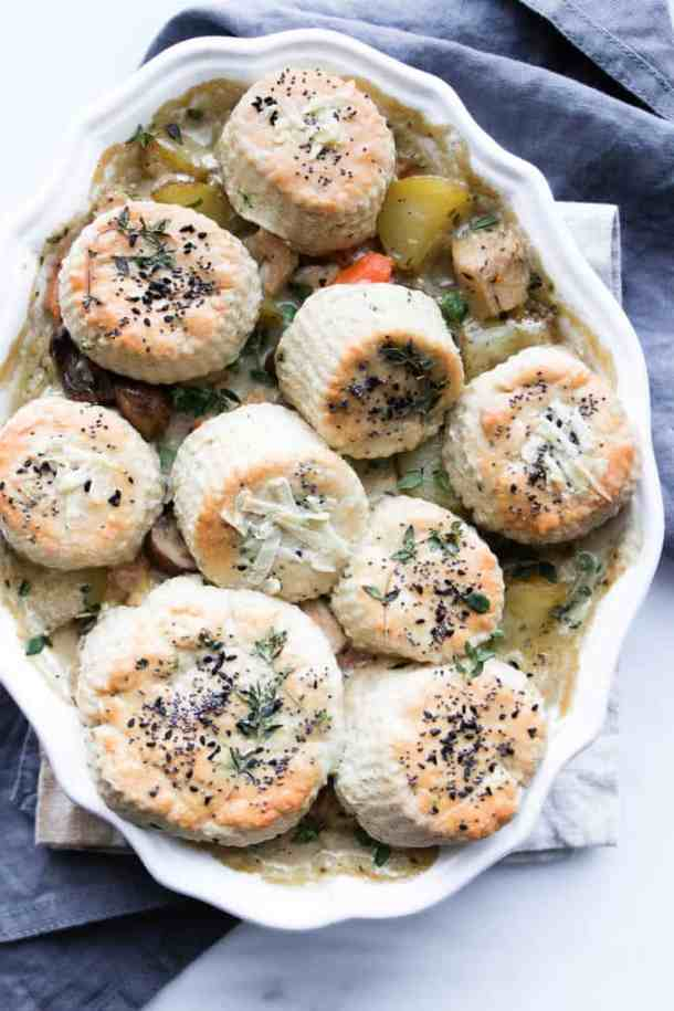This turkey and mushroom pie with herb biscuit topping is the cosiest way to use up leftover turkey. The simple biscuit topping elevates this pie to a luxurious dinner. Perfect for cosy and casual entertaining.