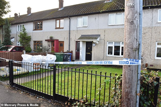 The attack took place at her terraced house in Cheshire. Pictured: The property cordoned off when police investigated