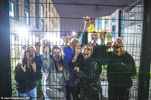 University chiefs have urged Boris Johnson to allow students to go back to campuses by April 12 after the Prime Minister failed to mention their plight in his press conference on Monday. Pictured: Students in isolation in Manchester last year