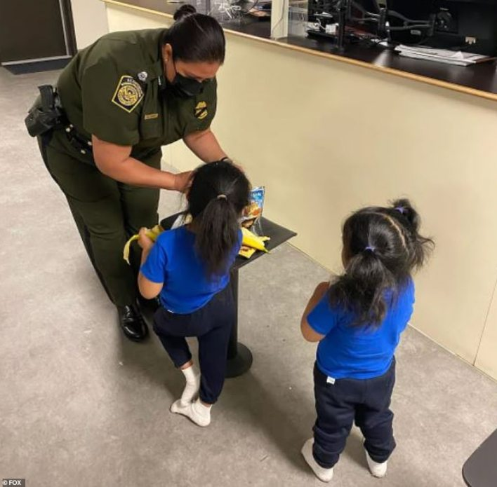 The sisters from Ecuador, who are aged three and five, were picturedinteracting with El Paso Sector Chief Patrol Agent Gloria Chavez after being rescued
