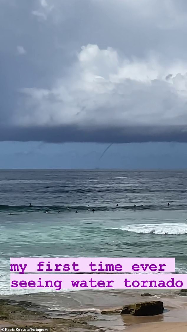 The unusual weather event is called a 'waterspout' - a type of wind vortex that develops over masses of water, scooping up vapour and dragging it towards the sky