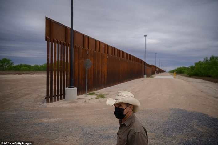Mayorkas said restarting construction would help fill 'gaps in the wall' as Biden's administration faces an increased immigration crisis and record numbers of illegal crossers