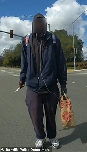 Police quickly released photos showing Wilson holding a shopping bag in his left hand and a folding knife in his right