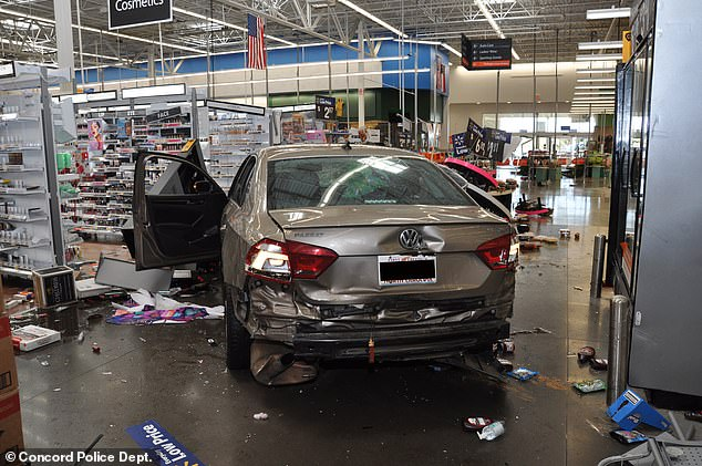 Photos from the scene of the Concord Walmart show significant damage to Gentry's vehicle as well
