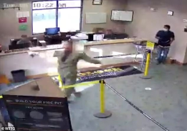 Surveillance video shows a sailor who was shot near the Fort Detrick Army base in Maryland on Tuesday entering a business and pleading for help while covered in blood