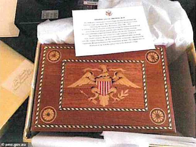 Former secretary of State Mike Pompeo presented Mr Morrison with a $3,700 mahogany dressing box etched with the federal eagle to symbolise freedom and democracy (pictured)