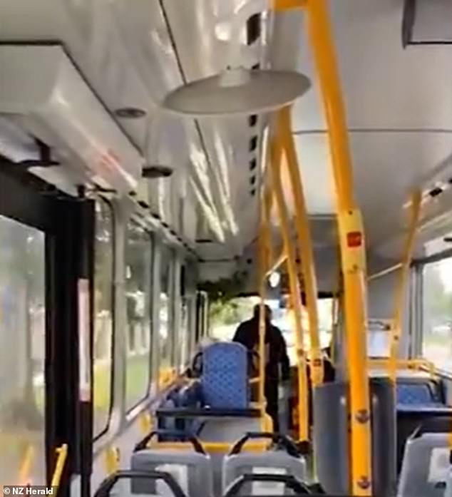 The man continues to hurl abuse at the driver as the bus comes to a sudden stop, asking her to 'open the f***king doors'