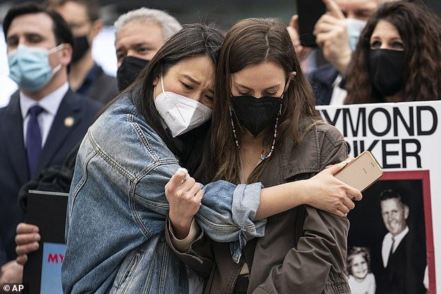 New York State Senator Alessandra Biaggi, right, and Assemblymember Yuh-Line Niou, left, hug as demonstrators gather for a rally decrying New York Governor Andrew Cuomo's handling of nursing homes during the COVID-19 outbreak on March 25, 2021