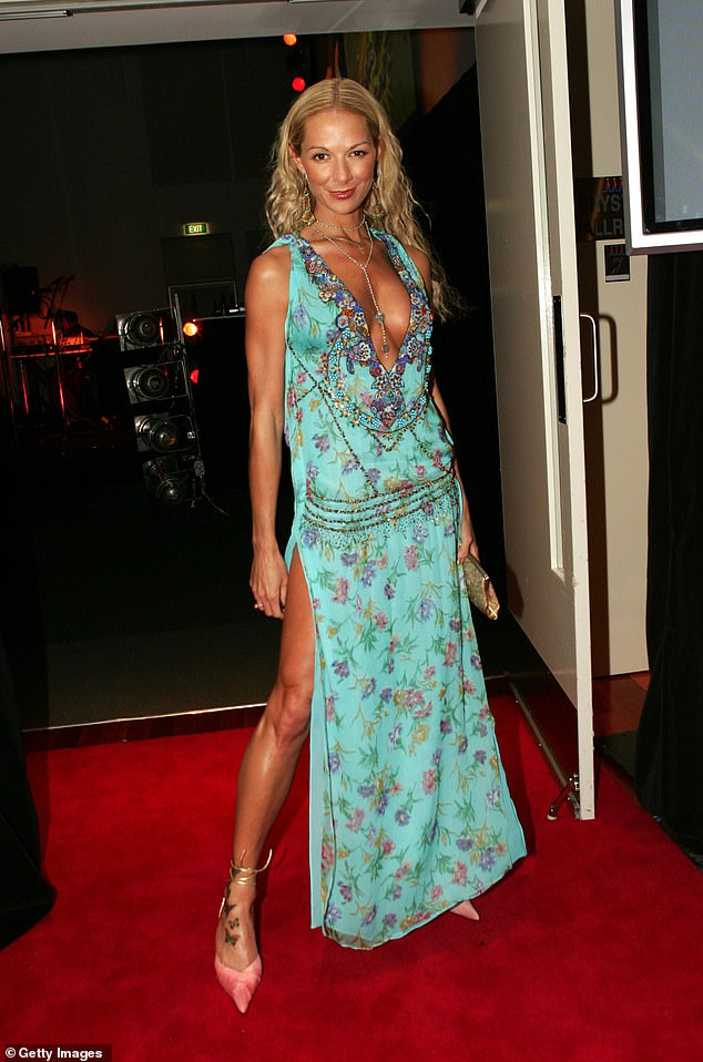 Pictured: Kylie Jaye at a cocktail party at the Crystal Palace at Luna Park in Sydney on October 27, 2004