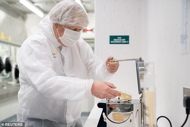 Boris Johnson, pictured during a visit to an AstraZeneca manufacturing centre in Macclesfield yesterday, is facing a Tory backlash over his domestic vaccine passports plans